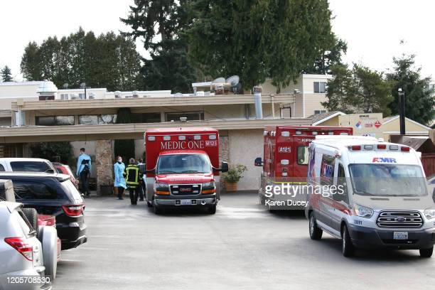 Several ambulances arrive at the Life Care Center on March 7 2020 in Kirkland Washington Several residents have died from COVID19 and six others have...