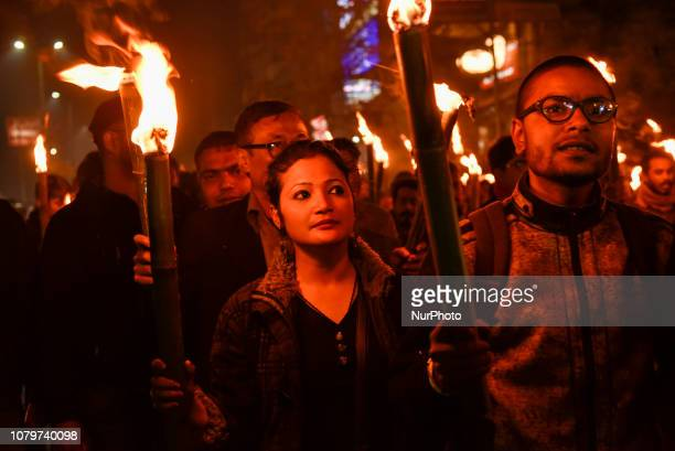 Several artists, Actors, singers of Assam with others taking out a Torch Light Rally in protest against Citizenship Bill 2016 in Guwahati, Assam,...