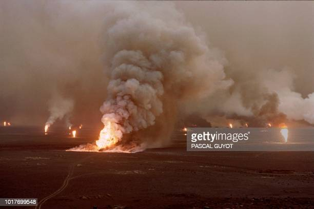 Several blownout wells damaged by retreating Iraqi soldiers in AlAhmadi oil field burn on April 1 1991 in southern Kuwait In 1991 Iraqi troops...