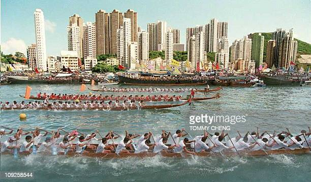 Several boats race during competition at the local dragon boat race 02 June at Hong Kong's Aberdeen Harbour to celebrate the annual Chinese festival...