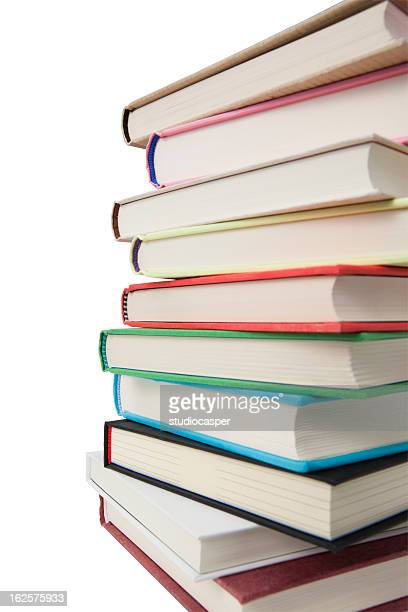 Several books stacked on top of each other