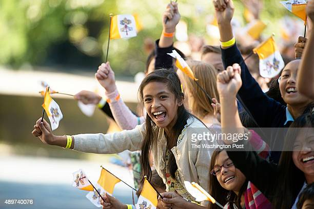 Several catholic school students cheer and greet Pope Francis as he returns to the Apostolic Nunciature to the United States in Washington DC on...