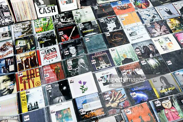 several cds from different artists in a store window - compact disc stock pictures, royalty-free photos & images