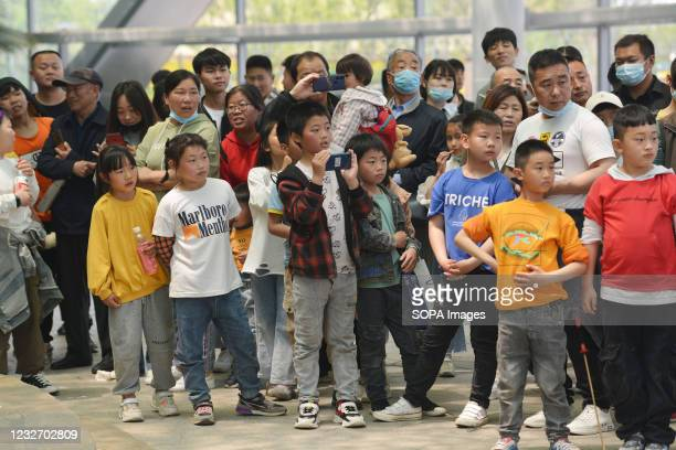"""Several children are seen watching performances at Fuyang ecological park during the May Day holiday. At the beginning of 2021, the """"cliff like""""..."""
