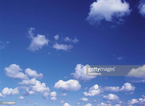 Several Clouds Floating in the Blue Sky, Low Angle View