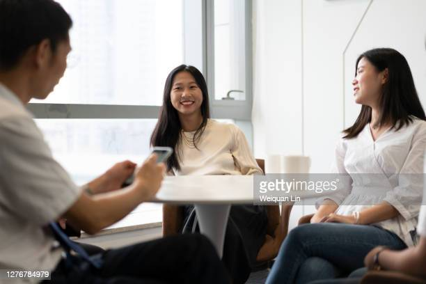 several colleagues are discussing - fujian province stock pictures, royalty-free photos & images