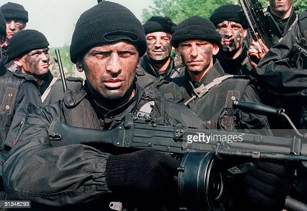 Several commandos members of the Arkan's Tigers train 17 June 1995 in Osijek a Serbheld area of Slavonia a region in eastern Croatia In 1990 Serb...