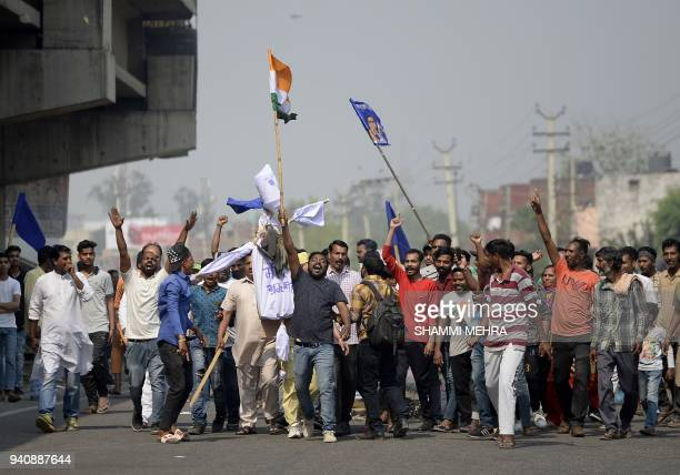 Several Dalit organisations block roads as they take part in a protest during a countrywide strike against a Supreme Court order that allegedly...
