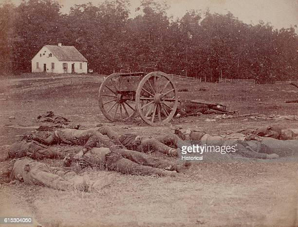 Several dead Confederate artillerymen lie outside Dunker Church after the Battle of Antietam The church was the location of some of the bloodiest...