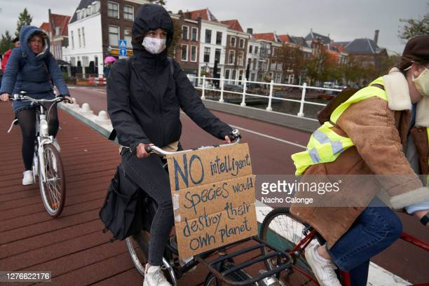 Several demonstrators carry banners against climate change on their bikes during the global day of climate action on September 25 2020 in Leiden...