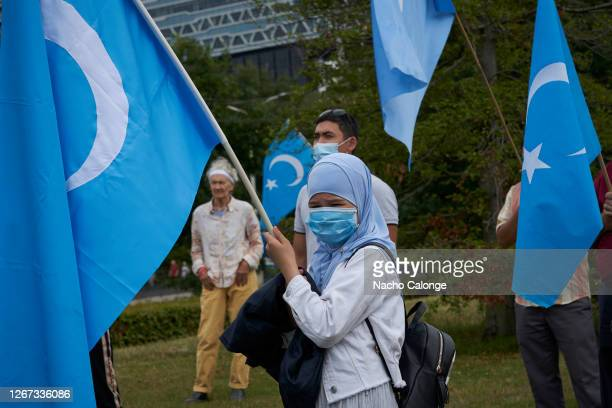 THE HAGUE NETHERLANDS AUGUST 20 Several demonstrators carry placards with messages against the Chinese government's policies against the Uyghur...