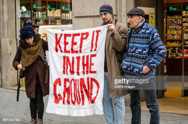 Several demonstrators seen with a banner in favour of renewable energies Coinciding with the Summit in Paris One Planet organized by Emmanuel Macron...