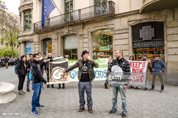 Several demonstrators seen with banners in favour of renewable energies during the protest Coinciding with the Summit in Paris One Planet organized...