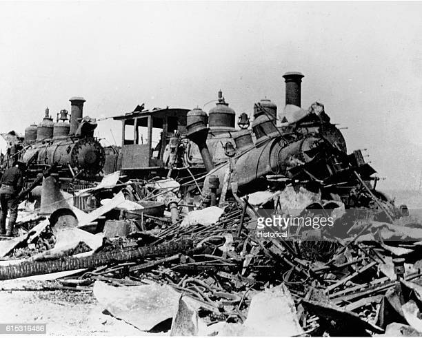 Several destroyed locomotives stand burned and crashed in Daiquiri Cuba during the SpanishAmerican War