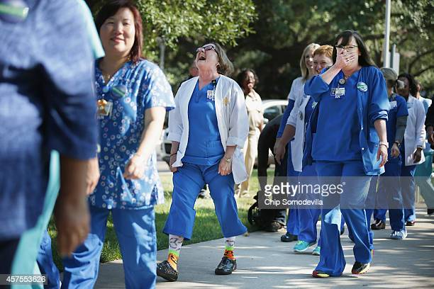 Several dozen nurses from Texas Health Presbyterian Hospital gathered in front of the hospital to show support for their employer October 20, 2014 in...