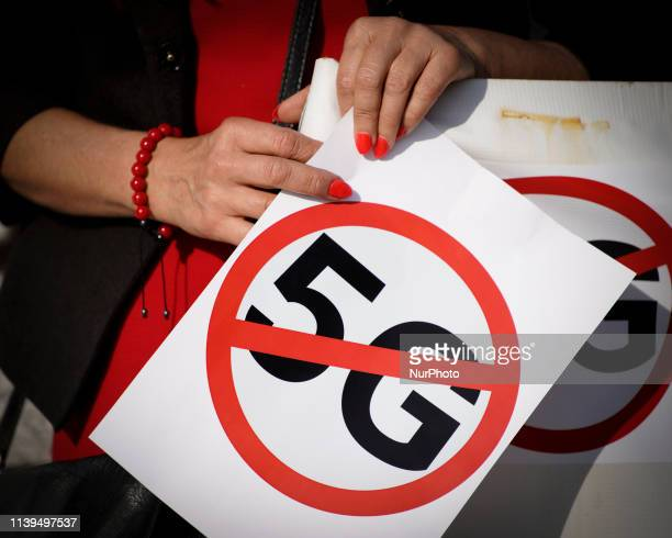 Several dozen people are seen attending a rally against the installment of 5G mobile networks in front Polish Parliament in Warsaw, Poland on April...