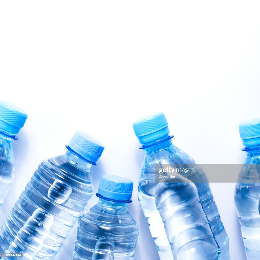 Several drinking water bottles on white background : Stock Photo