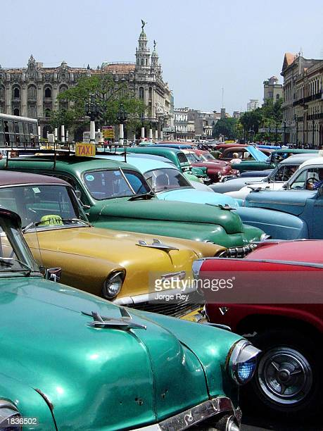 Several earlier model Americanmade cars wait to be rented March 7 2003 in Havana Cuba Supporters to end the US travel ban to Cuba in the US Congress...