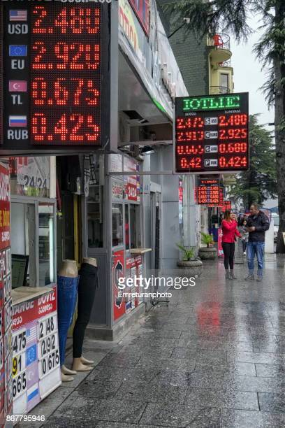 several excahange offices with digital displays in one street in downtown batumi. - emreturanphoto stock pictures, royalty-free photos & images