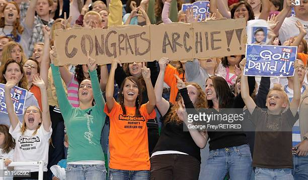 Several fans hold signs and cheer for David Archuleta, a finalist on American Idol, at the Energy Solutions Arena May 21, 2008 in Salt Lake City,...