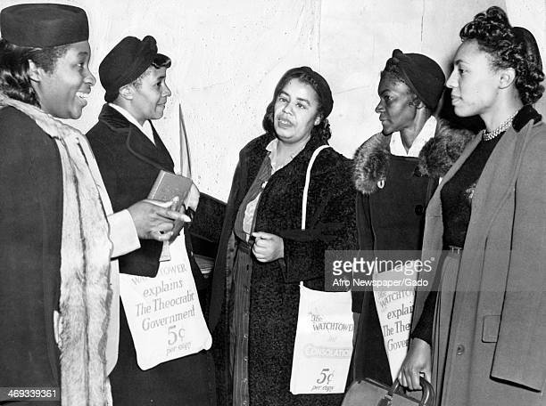 Several female members of Jehovah's Witnesses who attended three day sessions of the religious sect at Newark's Mosque Theatre Newark New Jersey...