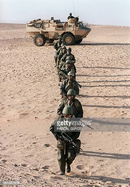 Several gasmasked French soldiers from the Foreign Legion Infantry regiment practice 23 October 1990 in the Saudi desert near Hafr alBaten NBC...
