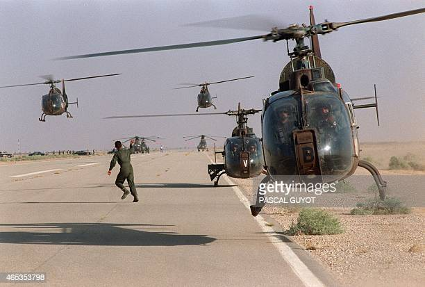 Several helicopters of French armed forces land 26 September 1990 at the military airport of Yanbu during the Gulf War Iraq's invasion of Kuwait 02...