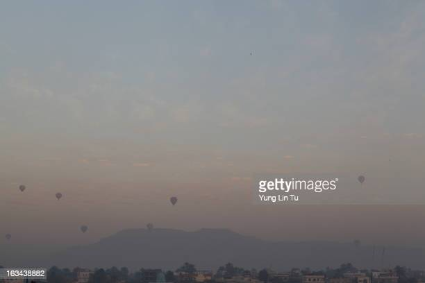 Several hot air balloon aired over the Luxor sky right before sunrise, taken from our cruise boat deck