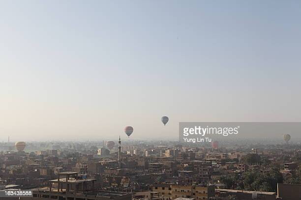 CONTENT] Several hot air balloon ready to land in the city of Luxor taken from out hot air balloon basket