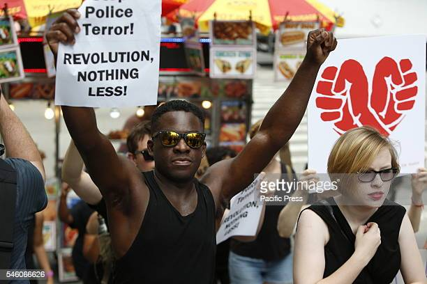 Several hundred activists gathered for a rally in Times Square to protest alleged police brutality in the deaths of several AfricanAmerican men after...