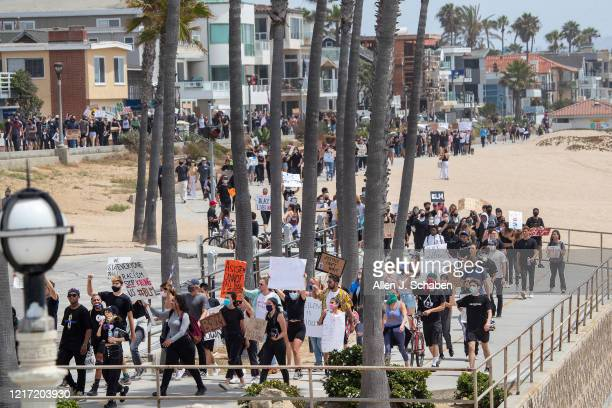 Several hundred Black Lives Matter protesters chant and march from Manhattan Beach to Hermosa Beach and return to demand justice for George Floyd...