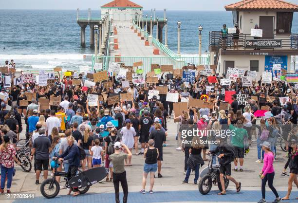 Several hundred Black Lives Matter protesters gather to demand justice for George Floyd at the Manhattan Beach Pier Plaza Tuesday, June 2, 2020.
