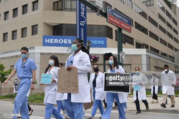 Several hundred doctors nurses and medical professionals come together to protest against police brutality and the death of George Floyd on June 5...