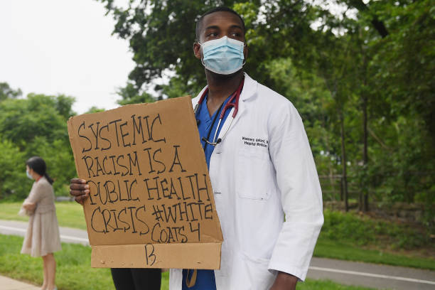 Several hundred doctors, nurses and medical professionals come together to protest against police brutality and the death of George Floyd at...