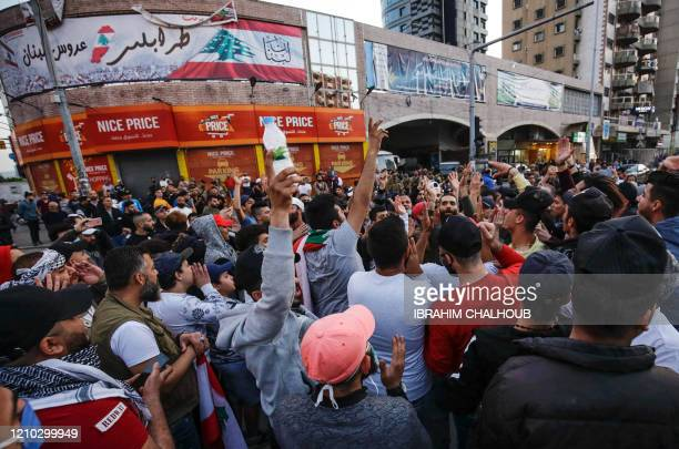 Several hundred Lebanese people protest in the northern city of Tripoli on April 17, 2020 despite the country's coronavirus lockdown, marking six...