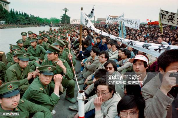 Several hundred of 200000 prodemocracy student protesters face to face with policemen outside the Great Hall of the People in Tiananmen Square 22...