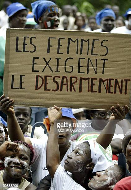 Several hundred 'patriot women' members of a group supporting Ivory Coast's President Laurent Gbagbo demonstrate 21 May 2004 outside the headquarters...