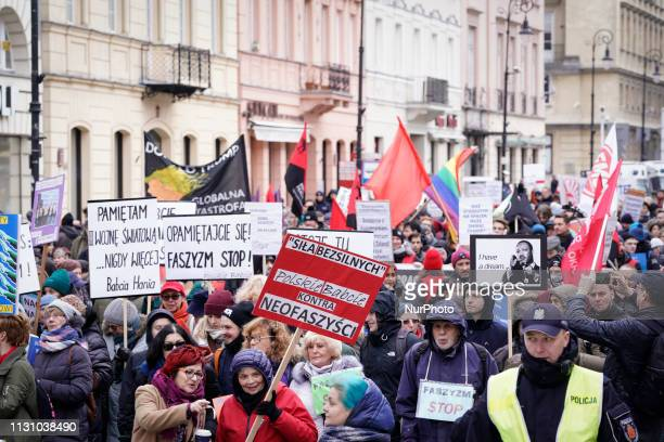 Several hundred people are seen gathered in the Old Town of Warsaw Poland on March 16 2019 to protest against increasing racism discrimination and...