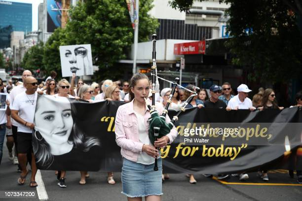Several hundred people walk up Queen Street in a silent march to remember Grace Millane on December 15 2018 in Auckland New Zealand The body of...