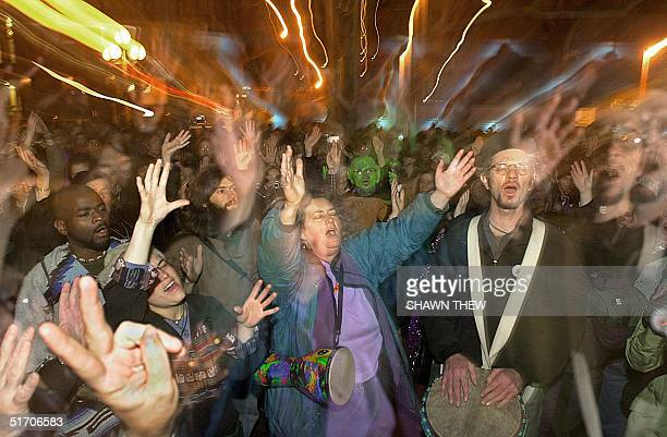 Several hundred protesters gather in Manhattan's Washington Square Park and participate in a pagan ritual festival spiral dance 01 February 2002 in...