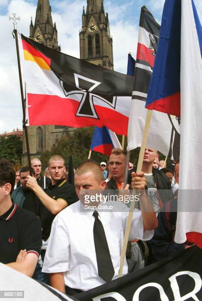 Several hundred skinheads from the Czech Republic and other European countries march peacefully through central Prague August 21 ostensibly in...