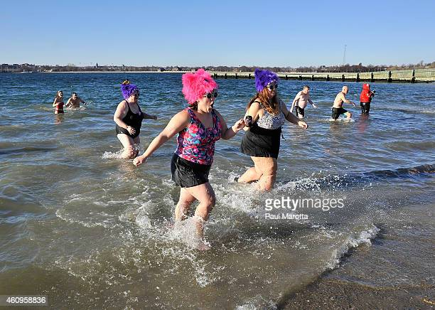Several hundred swimmers brave the 24 degree Fahrenheit air temperature to participate in the L Street Brownies annual New Year's Day Boston Polar...