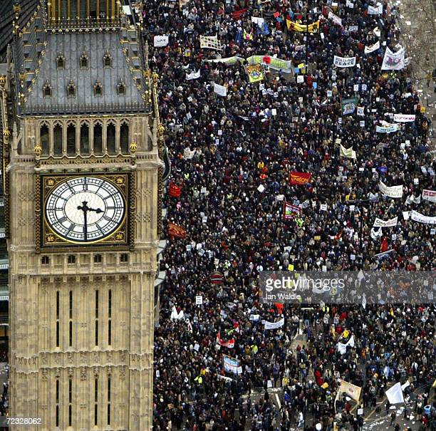 Several hundred thousand people march past the Westminster Clock Tower towards Hyde Park to protest against the proposed war in Iraq February 15 2003...