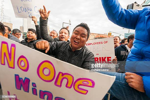 Several hundred Uber drivers and their supporters strike in front of Uber's Queens offices in New York on Monday, February 1, 2016. The drivers are...