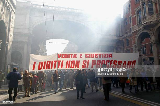 Several hundreds of demonstrators holding up a banner reading Truth and Justice Don't Put Civil Rights on Trial protest outside Genoa's courthouse 02...