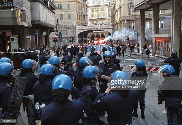 Several hundreds of demonstrators protest outside Genoa's courthouse 02 March 2004 as 26 people went to trail for rioting and looting during the...