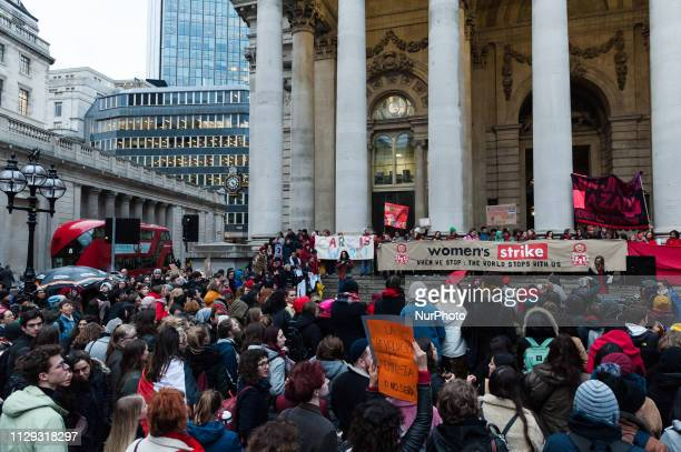 Several hundreds of women take part in Women's Strike outside the Bank of England in London on 08 March protesting against harassment exploitation...
