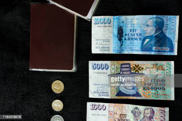 several icelandic krona bills and blank passport . icelandic krona is the national currency of iceland (kronur) ,travel iceland .vacation concept - スウェーデン通貨 ストックフォトと画像