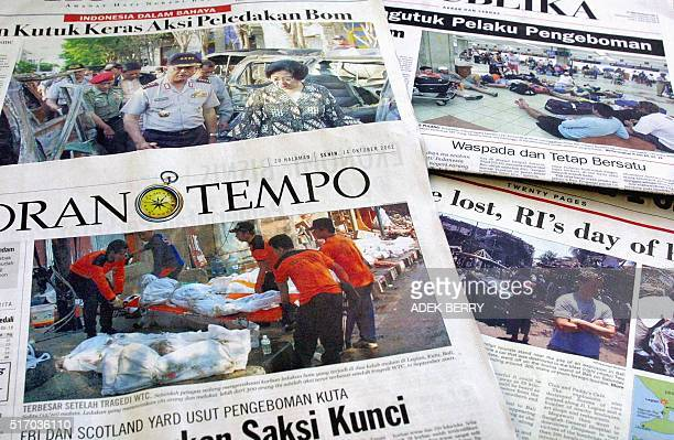 Several Indonesian newspapers in Jakarta 14 October 2002 show pictures of the blast aftermath in Bali where at least 190 people were killed when a...