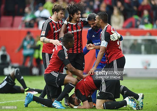 Several Ingolstadt players celebrate after the German Bundesliga first division football match between FC Ingolstadt 04 and Borussia Moenchengladbach...